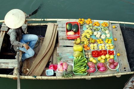 plum island: some fruits on boat - vietnam