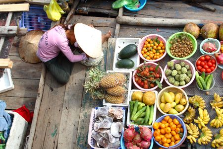 plum island: some fruits on boat - vietnam