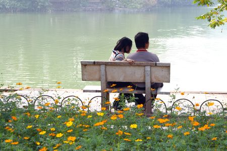 Girl And Man In Love with water in background Stock Photo - 2319424