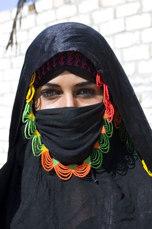 HURGHADA, EGYPT - AUGUST 4: Portrait of young Arabian woman wearing a black head covering on August 4, 2010 in Hurghada, Egypt. Hurghada is a very popular health resort for tourist from Europe.