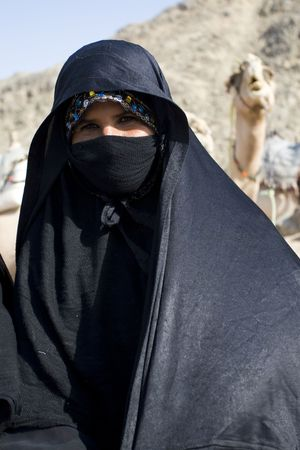 HURGHADA, EGYPT - AUGUST 4: Portrait of old Arabian woman wearing a black head covering on August 4, 2010 in Hurghada, Egypt. Hurghada is a very popular health resort for tourist from Europe.