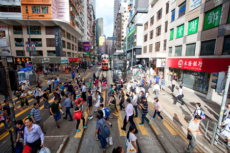 HONG KONG - JULY 18, 2017: busy city people crowd on zebra crossing street