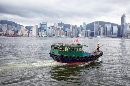 HONG KONG - JULY 16, 2017: Traditional wooden sailboat sailing in Victoria harbor