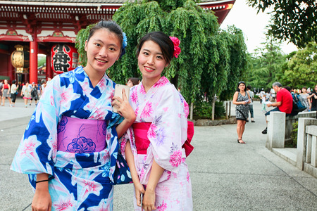 Tokyo, Japan - August 10, 2016: Modern japanese girls in traditional kimono on the way to the temple, Asakusa district