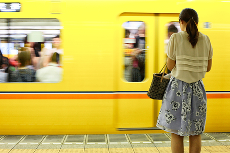 Tokyo, Japan - August 10, 2016: Passengers traveling by Tokyo metro. Business people commuting to work by public transport in rush hour.