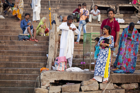 VARANASI, UTTAR PRADESH, INDIA - JULY 7 2018: Pilgrims bathing and performing the holy water. Ganges river in the early morning