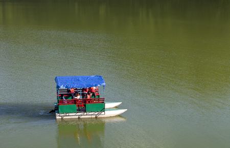 Small boat on the Phewa Lake in Pokhara, Nepal