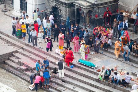 KATHMANDU, NEPAL - JULY 12, 2018: Temple of the Pashupatinath crematorium. People believe that cremation will give a spiritual rebirth
