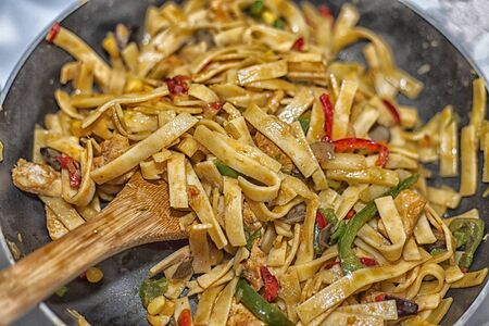 Bami Goreng is a pasta dish. Dish is made on a indonesian way with chicken brast and pasta. Stockfoto