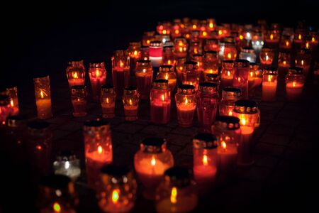 Many burning lanterns in memory of the fall of Vukovar in the war. Feeling of sadness, pain and suffering. Laterns represent the memories of loved ones. On the day of the fall of Vukovar, many people light lanterns and remember the difficult times. Stock Photo