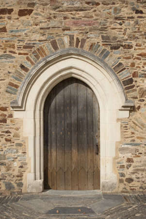 Medieval door and brickwall photo