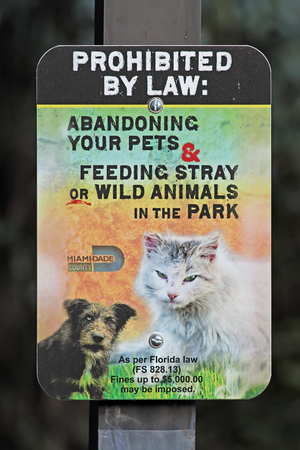 A sign in Miamis A.D. Doug Barnes Park warns against abandoning pets or feeding animals in the park