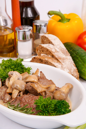 Fricassee of veal brisket with mushrooms Stock Photo