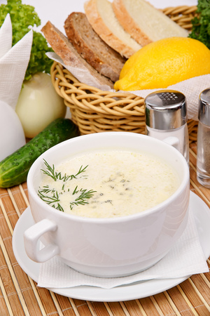cream soup with cheese in a white plate