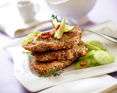 Turkey breast cutlets coated with sesame crumble.