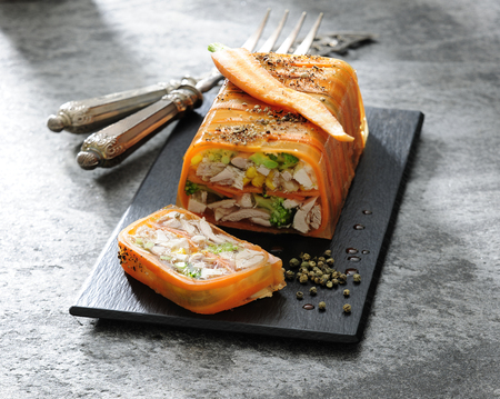 Aspic jelly terrine with chicken and vegetable.