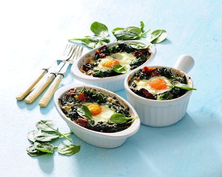 Baked eggs with spinach and tomatoes.
