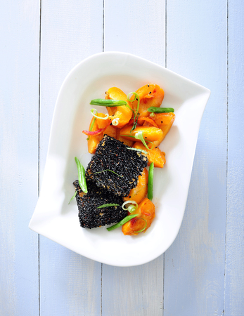 Tofu in black sesame with  marinated peach.