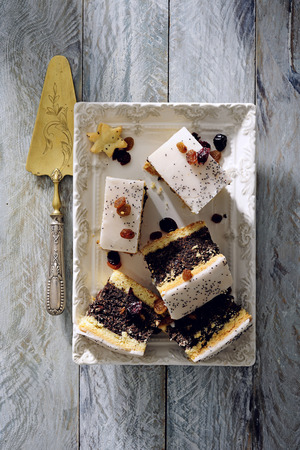Poppy seed cake with vanilla frosting.