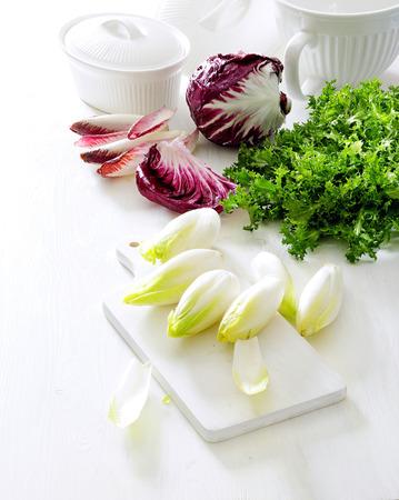 Salad greens.