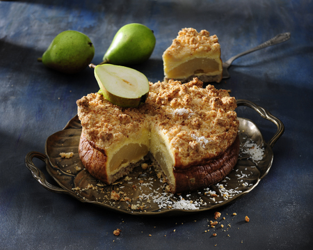 Pear cheesecake with coconut crumble.