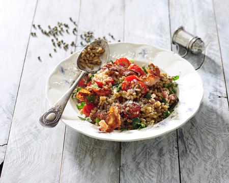 Pearl barley, pork and tomato risotto. Stockfoto