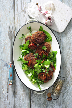 Lamb and feta burgers with salad greens.