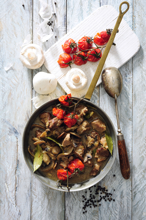 Beef and champignon goulash with sour cream and cherry tomato.