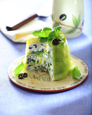 Feta terrine with spring onion, leek and black olives.