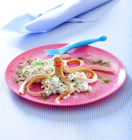 Octopus hot dog and cottage cheese on pink plate. Stock Photo