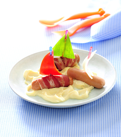 Mini hot dog boats and mashed potato for funny dinner for kids.