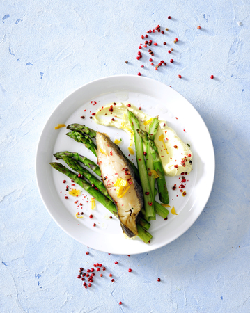 Oven baked sea fish fillet with asparagus and herb butter served with cheese pureed potato