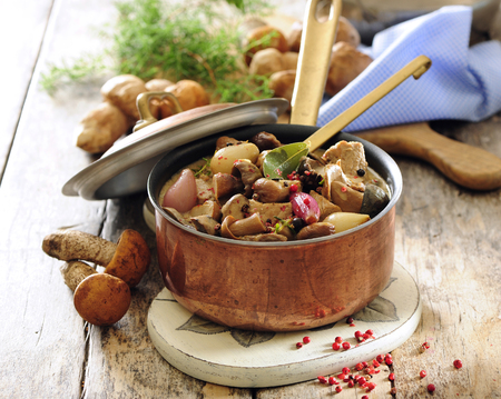 Wild mushrooms and potato stew or goulash with butter and herbs.