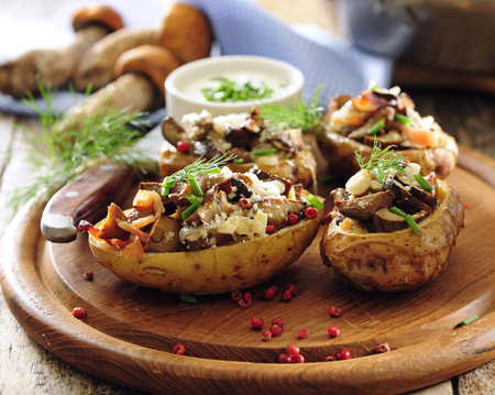 Baked halves of potato stuffed with forest wild mushrooms. 写真素材