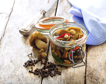 Polish or Russian picked mushrooms preserved in vinegar.