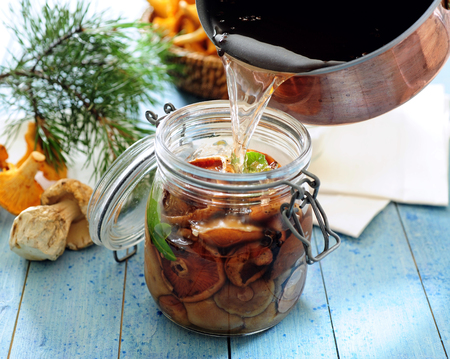 Preparatiion of Polish or Russian picked mushrooms preserved in vinegar.