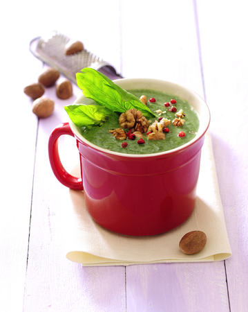 Cream of spinach soup with walnuts and nutmeg. 写真素材