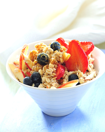 Oatmeal granola porridge with strawberry, blueberry and apple.
