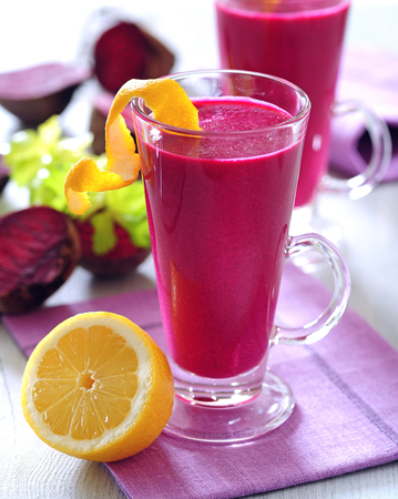 Detox fresh red beetroot juice drink with lemon.