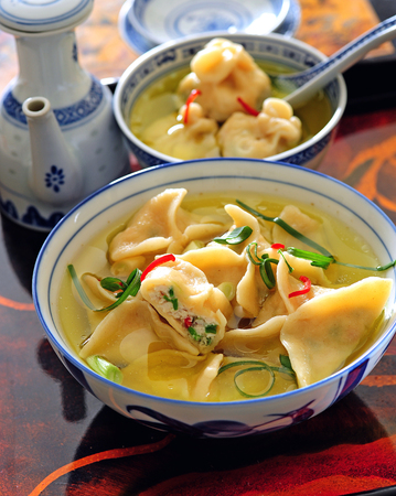 Wonton chinese stuffed meat dumplings served in soup 写真素材