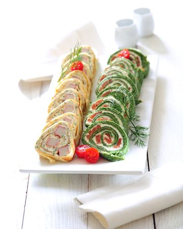 Party quark cheese and pancake roulade slices.