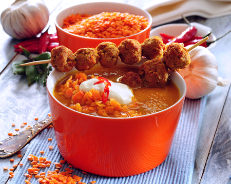 Spicy red lentil soup with mini meatballs skewers