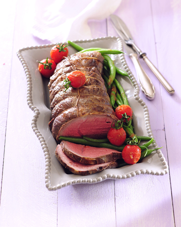 Gentel and slow roasted beef tenderloin with green beans and cherry tomato. 写真素材