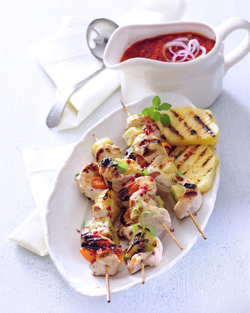 Sour and sweet grilled turkey skewers with pinapple, kiwi and apricot.