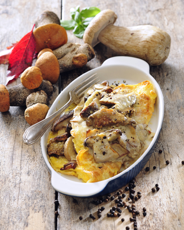 Baked eggs omelette with fresh wild mushrooms