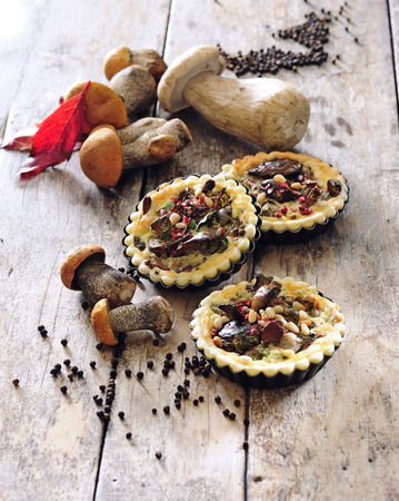 Summer wild mushrooms mini tartelettes with savory short - crust pastry.