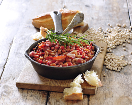 Quick  baked white bean with smoked bacon.