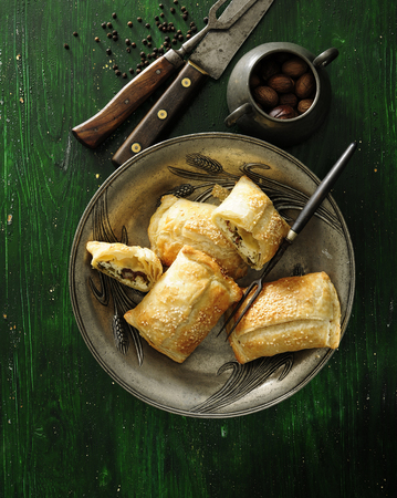 Puff pastry pockets or calzone with cheese, dry tomato and olives. 스톡 콘텐츠