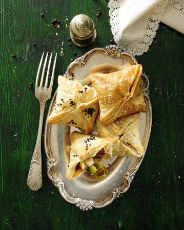 Puff pastry pockets with vegetable and cheese filling.