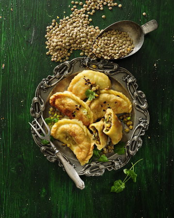 Vegetarian pan-fried dumplings filled with green lentil and coriander.